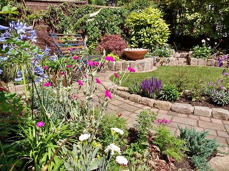 Didsbury front garden with curving brick