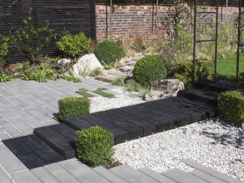 Rear Garden across patio after