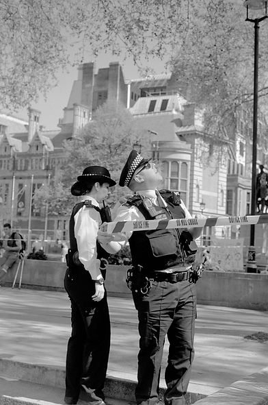 Met Police looking at protestors in trees above Sir Robert Peel - Extinction Rebelion Protest, Parliament Square, April 2019