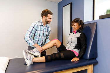 Physical Therapist Working With Knee Pai