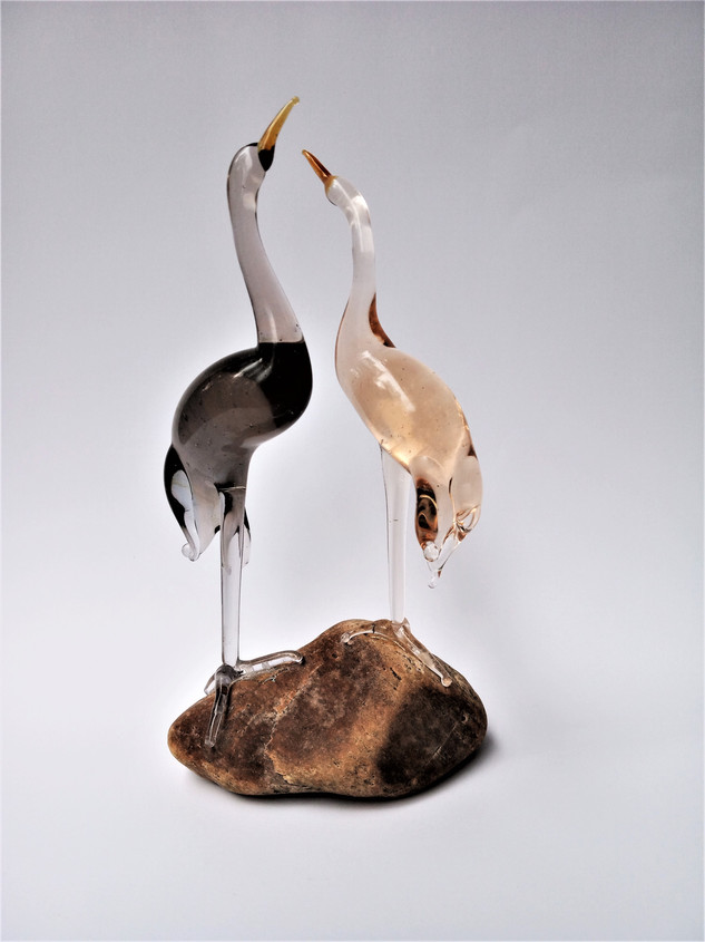 Pink and gray birds figurines