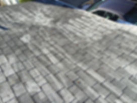 Damage to asphalt shingles caused from pressure washing. Non-pressure roof cleaning would be the superior service.