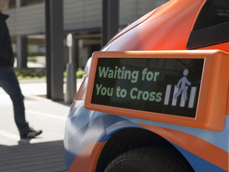 To Get Ready for Robot Driving, Some Want to Reprogram Pedestrians
