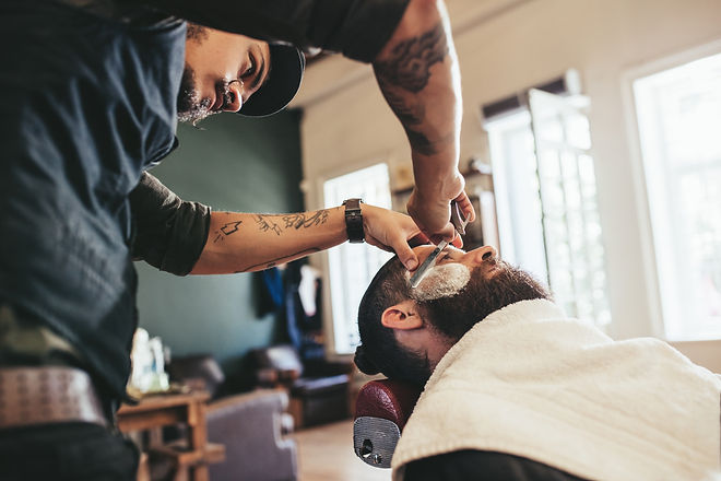 Professional Barber Shaving Client