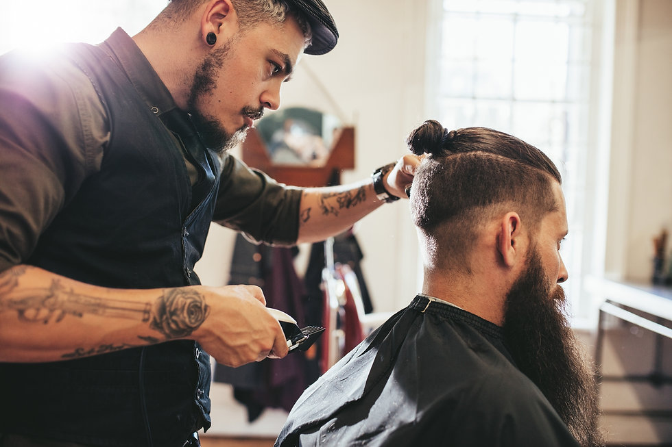 Client getting trendy cut in barbershop