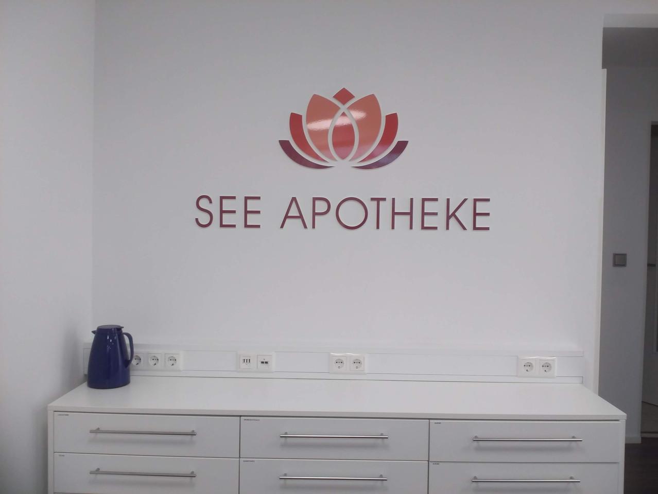 Logo See Apotheke als Fassadenwerbung