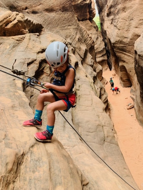 Young girl rappelling