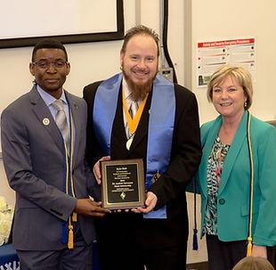 Kyle Holt Receiving the Kappa Beta Delta Andrew V. Stevenson Award