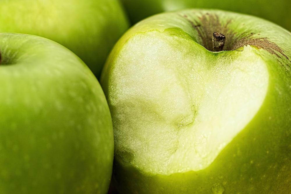 green apple, bite, money, inflation