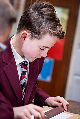 Photo of a pupil working in lessons