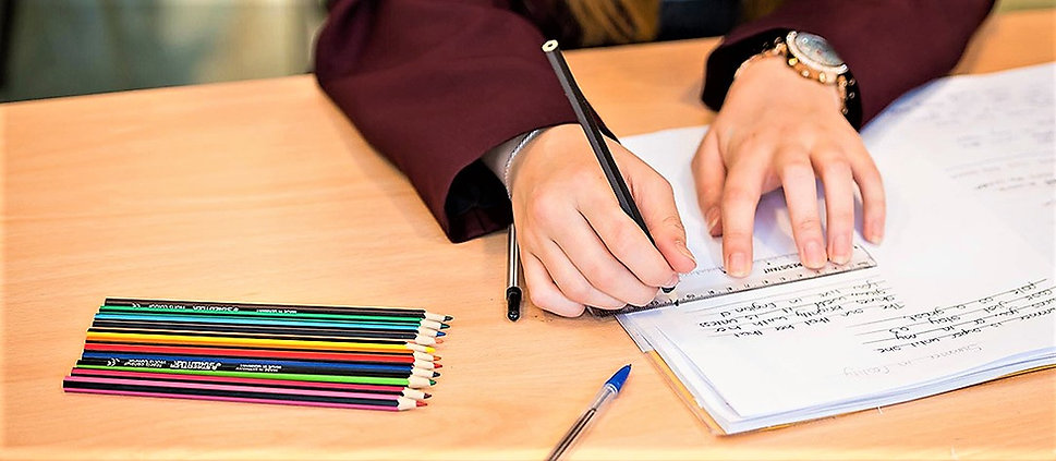 Picture of pupil's hands writing.jpg