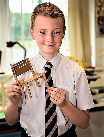 Picture of pupil showing their pruduct made in product design class.jpg