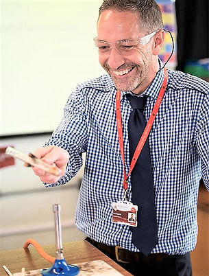 Picture of Teacher conducting Science experiment.jpg