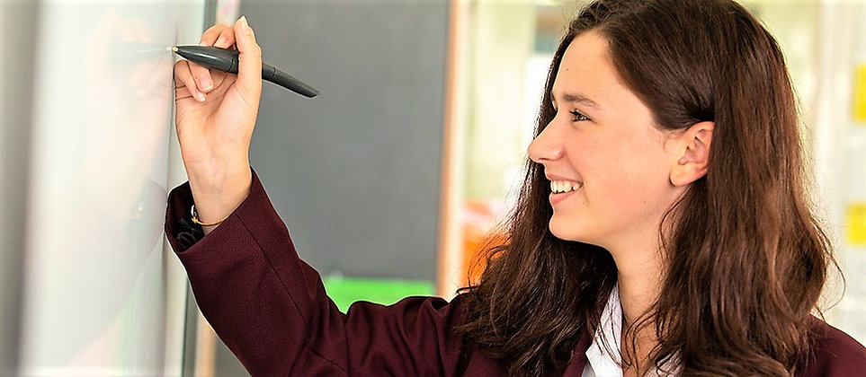 Pupil writing on whiteboard.jpg