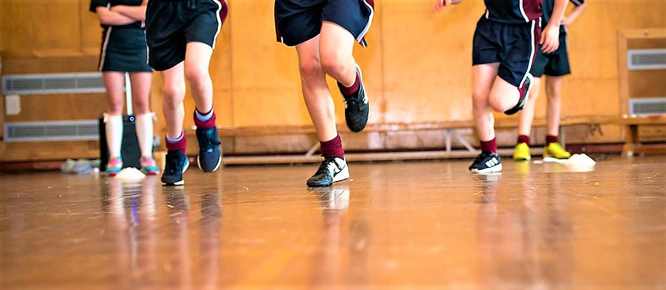 Picture of pupils running in Byrchall Gym.jpg
