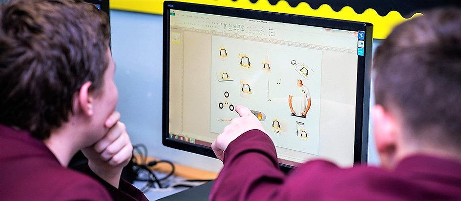 Pupils studying a computer screen.jpg