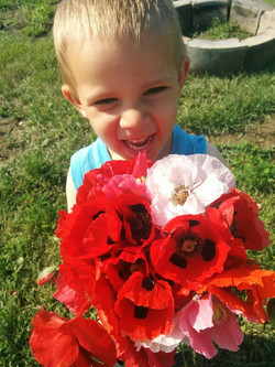 kid with poppies