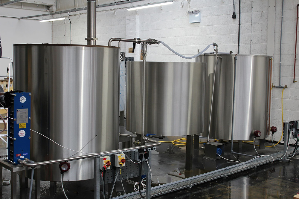 A new brew kit installed at Nomadic Beers, showing the hot liquor tank, the mash tun & the copper.