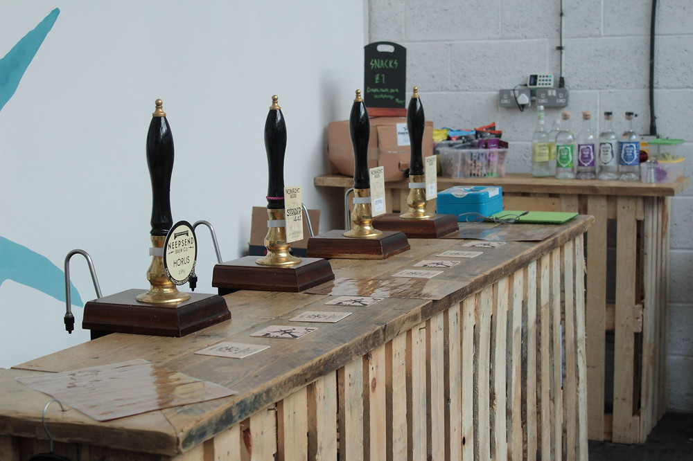 A bar at Nomadic beers, with four hand pulls