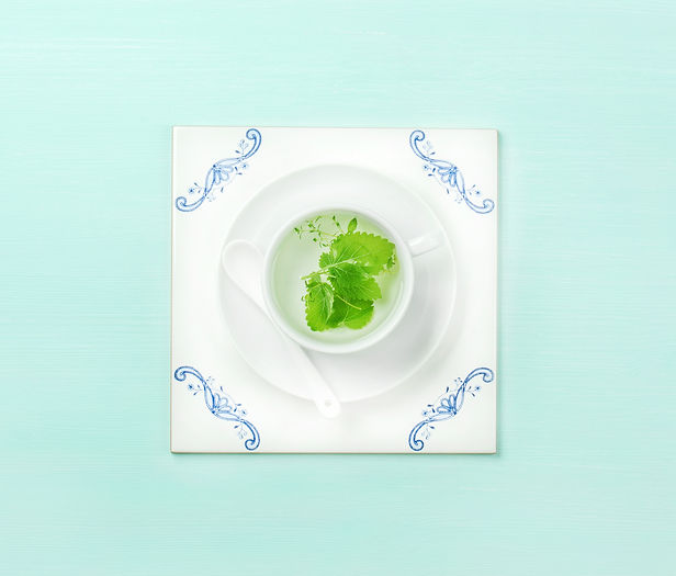 cup-of-tea-on-white-tile-board-over-mint