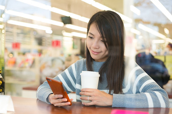 asian-young-woman-use-cellphone-at-coffe