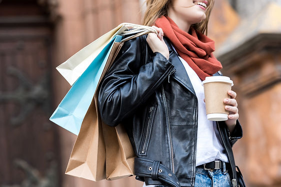 partial-view-of-woman-with-shopping-bags