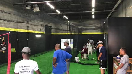Reggie of the DC Knights taking bp in virtual pitching cage with real balls at On Deck PG Batting Cages