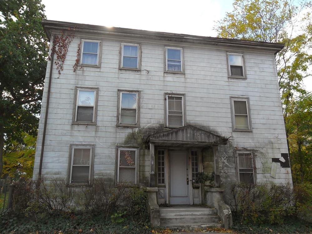 Creepy Dilapidated House near the The Burying Point Cemetery, Salem, Massachusetts