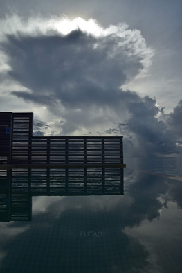 Reflection from over-water pool bungalow at Hurawahli Resort