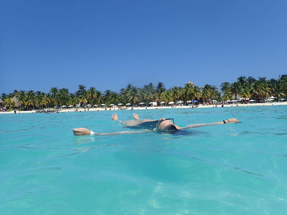 D floating in the crystal clear water, Cancun, Mexico