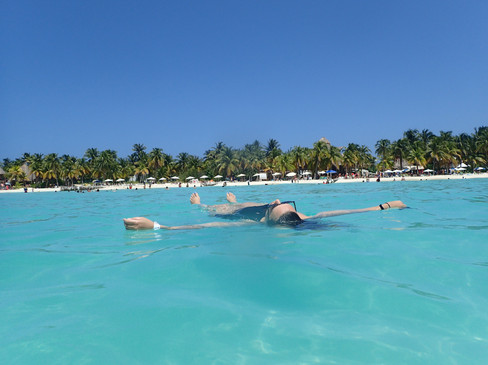 D floating in the crystal clear waters of Isla Mujeres Beach