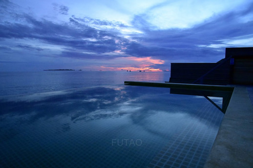 Sunrise from over-water pool bungalow at Hurawahli Resort