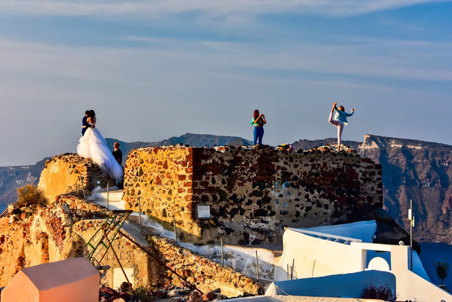 Bad Tourists on the ruins of the Byzantine Castle, Oia, Santorini, Greece