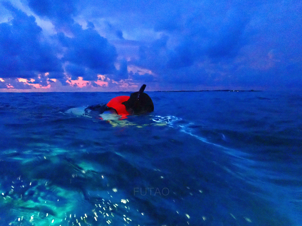 J beginning the night snorkel as the sun set, Maldives
