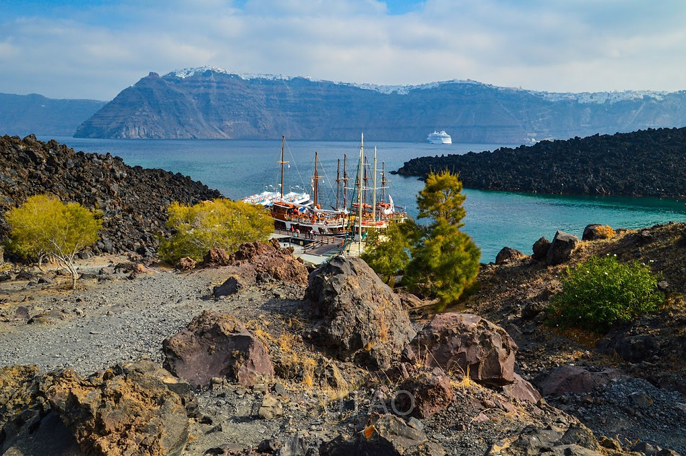 Climbing to the top on Nea Kameni, with the sailboats we arrived on in view, Santorini, Greece