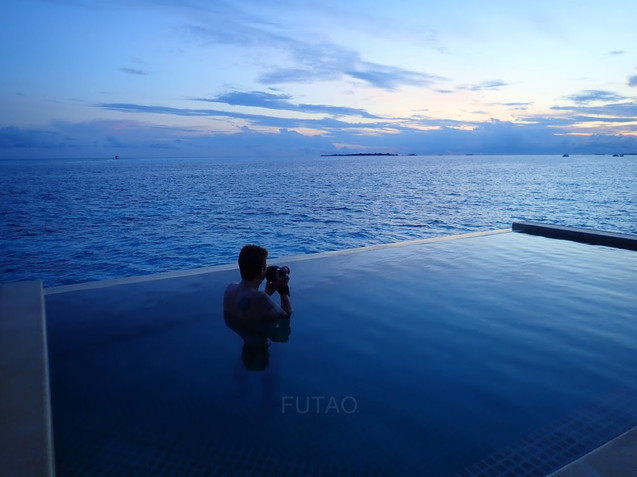Capturing the sunrise from the over-water pool bungalow at Hurawahli Resort