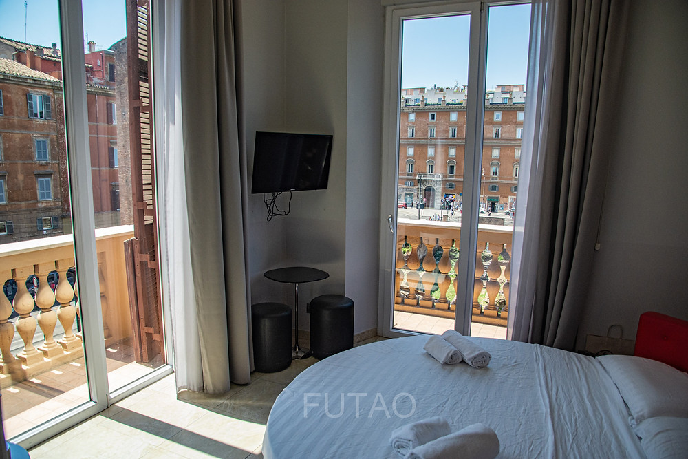 View of our room and wrap-around balcony (with round bed) in the Pantheon Caesar Relais Hotel, Rome, Italy