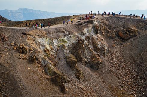 Hiking the lava islet of Nea Kameni, Santorini, Greece