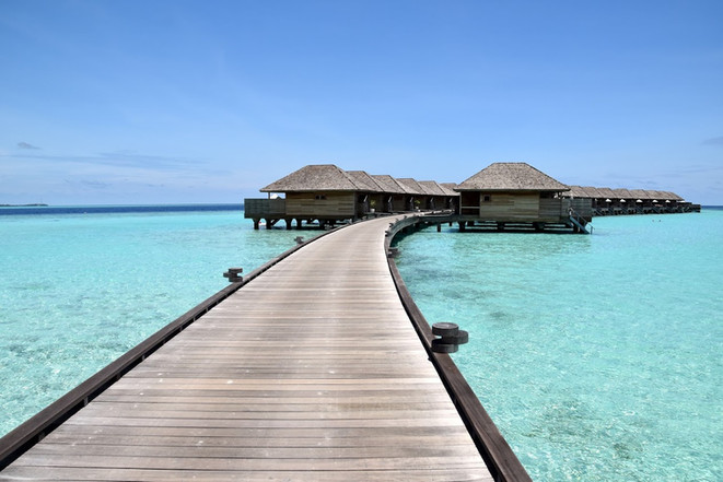 Path to the over-water bungalows at Hurawahli Resort