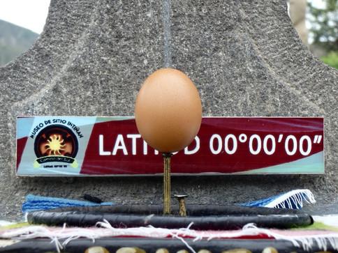 Balancing an egg on a nail at Cuidad Mitad del Mundo, Quito, Ecuador