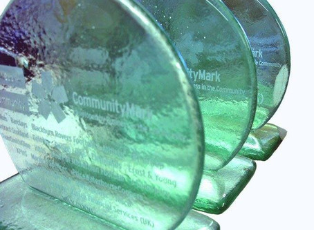 Ethical Accolades: Financial Tombstones in Recycled Glass
