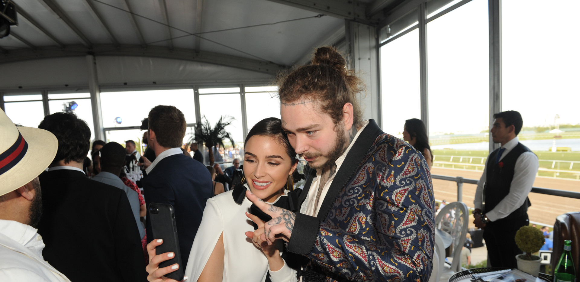 Olivia Culpo & Post Malone taking selfie