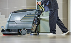 stock-photo-48322716-worker-cleaning-floor-with-machine