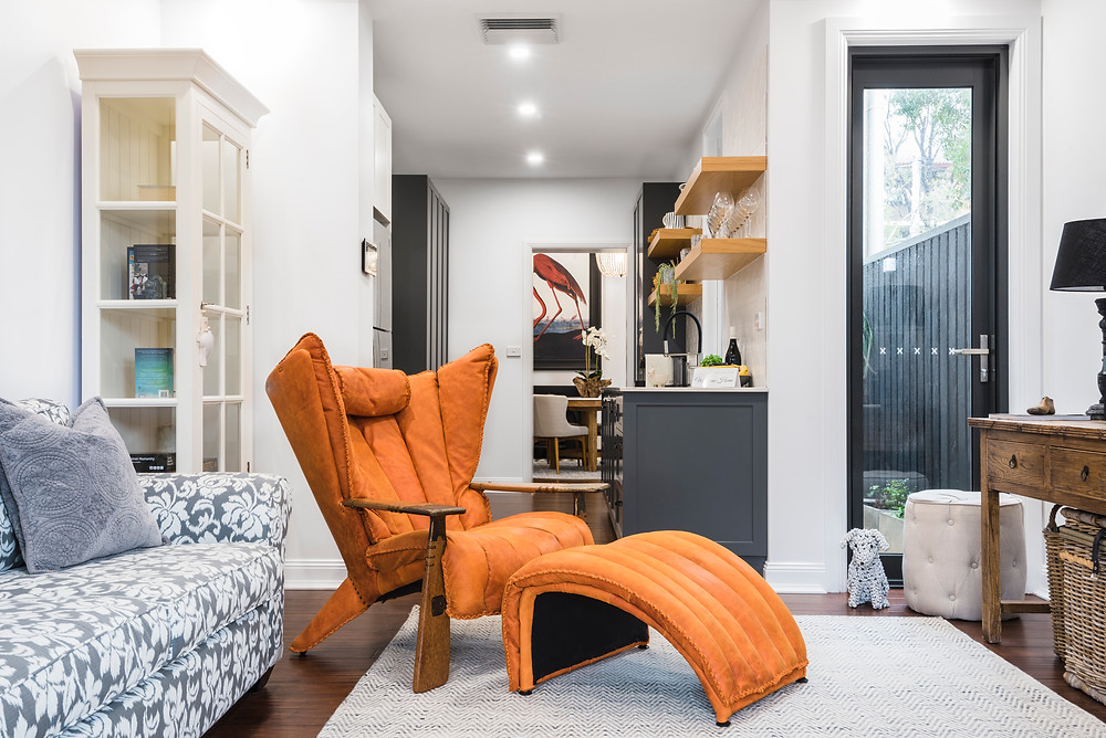 Brunswick Mews, Verite orange armchair, luxury accommodation in Newcastle, Newcastle boutique accommodation, Newcastle B&B