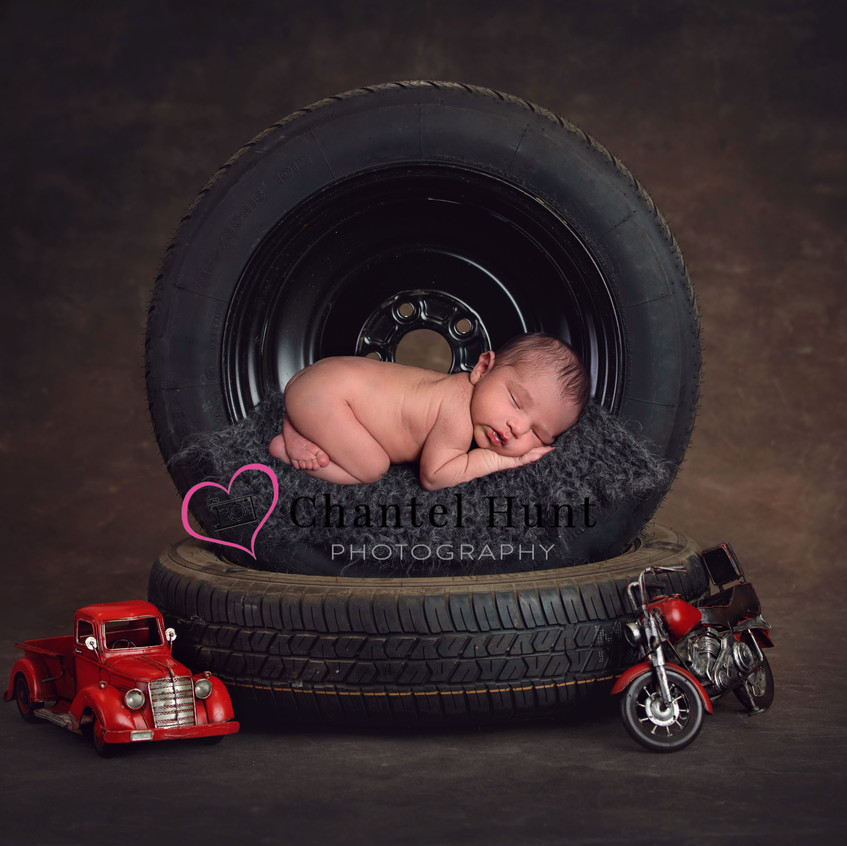 Baby Boy Newborn Pictures.  This mechanics themed image was captured by Chantel Hunt Photography in Yuba City, CA