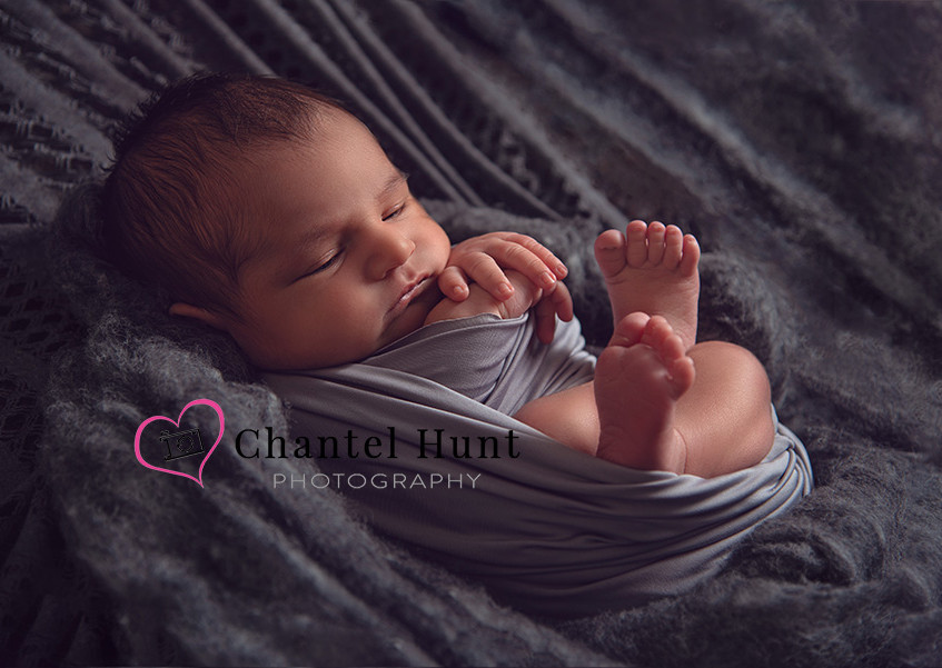 This Baby Boy picture is back lit to capture the innocent details of a newborn.  Photography by Chantel Hunt Photography in Yuba City, CA