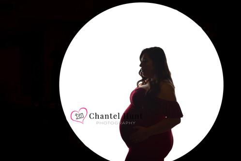 creative pregnancy photograph in yuba city red dress