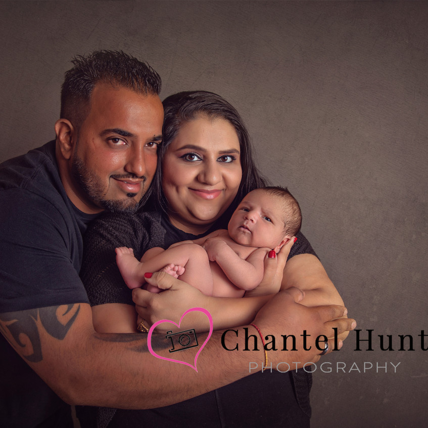 Proud parents with their newborn.  Captured by Chantel Hunt Photography, Yuba City, CA