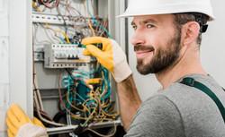 electrician-repairing-electrical-box-id1