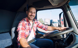 truck-driver-driving-his-truck-and-chang